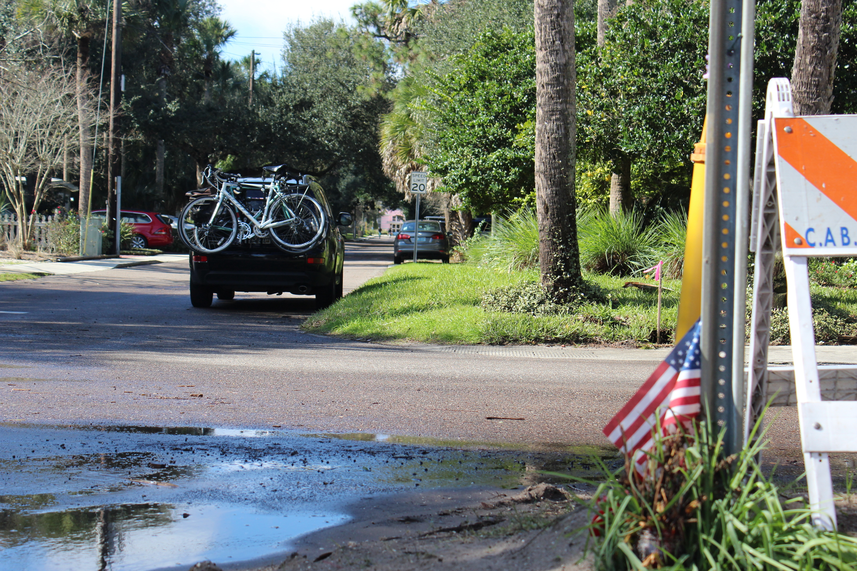 background image, Florida street scene with bikes on the back of a parked van
